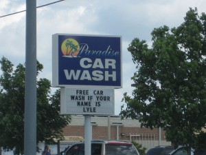 """Free car wash if your name is Lyle."" This is not the Quick Quack Car Wash. We thought it was funny. (Photo: Flickr)"