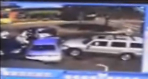 A security camera captures an SUV ramming into several other cars at a car wash in Oregon. (Photo: Screenshot/kgw.com)