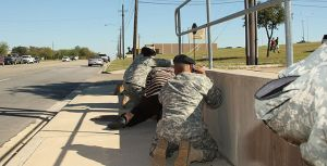 "Scene from the 2009 Fort Hood Shooting (""Flickr - The U.S. Army - Taking cover at Fort Hood"" by The U.S. Army - Taking cover at Fort Hood. Licensed under Public domain via Wikimedia Commons)"
