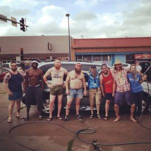 Members of the Omaha Facial Hair Society held their first charity car wash in 2014. The group raised $560 at the event and hopes to triple it at this year's wash, which will be held Saturday at The Nifty Bar parking lot.