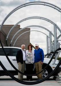From left, Greg Bomgaars, Jen Trimble and Eric Stoffel pose on the premise of Wash N Gloss Car wash and detail center on Wednesday morning in Greeley. | The Tribune
