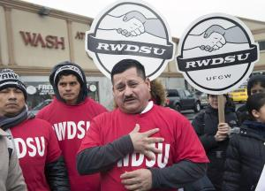 Simon Salvador, Fermin Amaya and Rigoberto Quintero, members of the union. The new contract eliminates a tip credit system in return for a base pay slightly more than minimum wage. | New York Daily News
